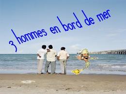 3 hommes en bord de mer